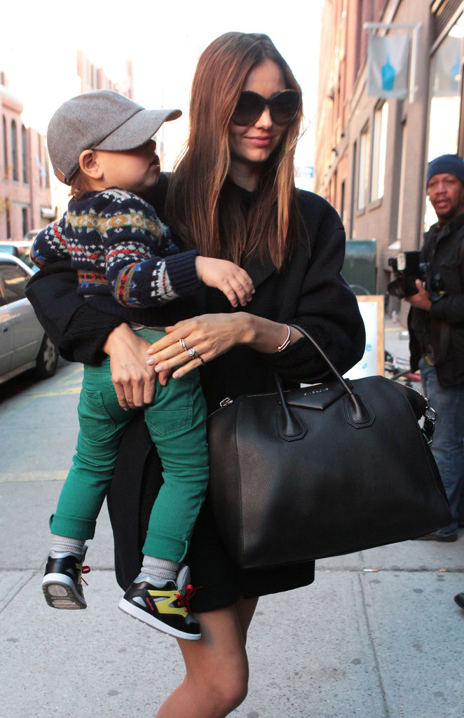 Miranda Kerr carried her son, Flynn, in NYC.