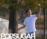 Leonardo DiCaprio tossed the ball up for a serve.