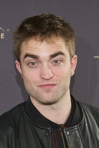 Robert Pattinson smiled for photographers in Madrid.