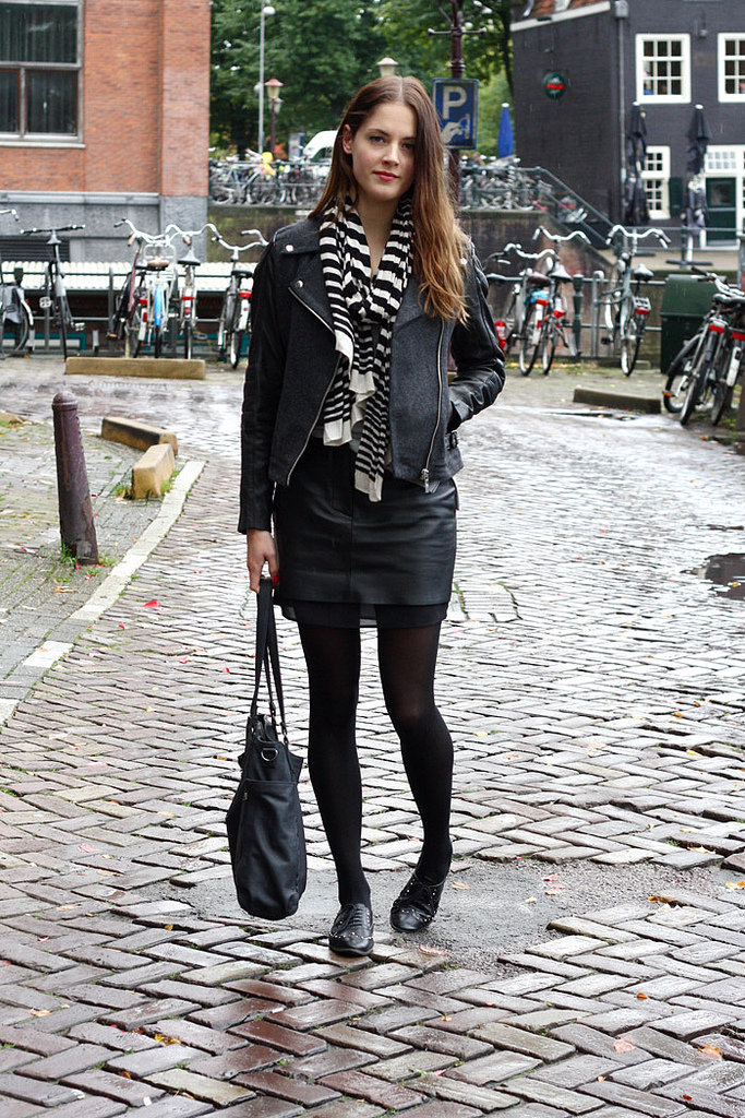 A mix of wool and leather texture — plus a cool striped scarf — incites a little more interest on an all-black ensemble. Source: Lookbook.nu