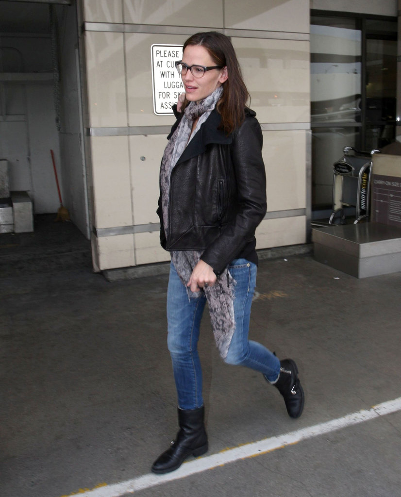 Jennifer Garner wore a leather jacket and scarf at LAX.