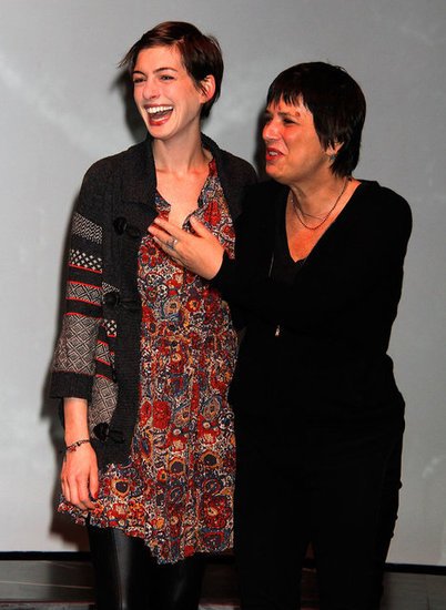 Anne Hathaway laughed with Eve Ensler.