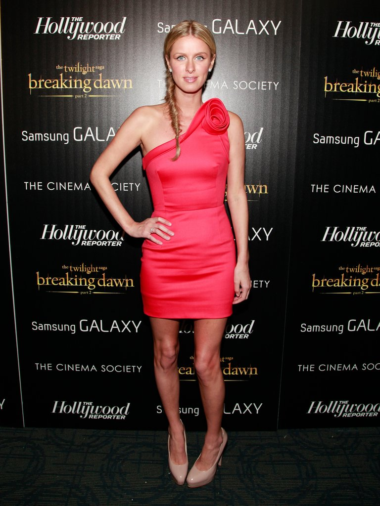Nicky Hilton got cocktail-chic in a red, one-shouldered minidress.