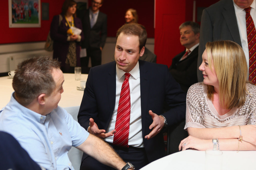 Prince William talked with former players and beneficiaries of the Charitable Trust in Cardiff.