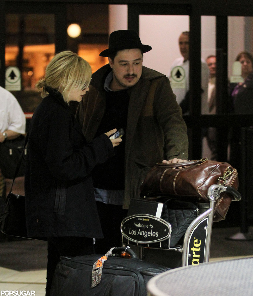 Carey Mulligan and husband Marcus Mumford arrived at LAX together.