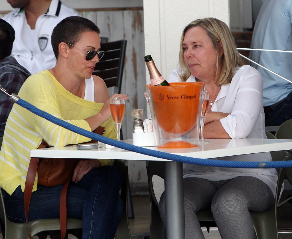 Charlize Theron and her mum, Gerda, chatted over Champagne.