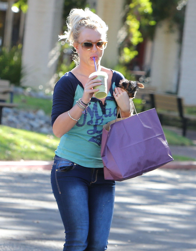Britney Spears held onto her pup and a cold drink.