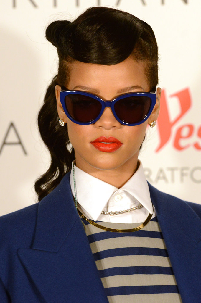 Rihanna accessorized her look with blue oversize cat-eye sunglasses.