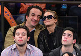 Mary-Kate Olsen and Olivier Sarkozy stayed close at a basketball game in NYC.