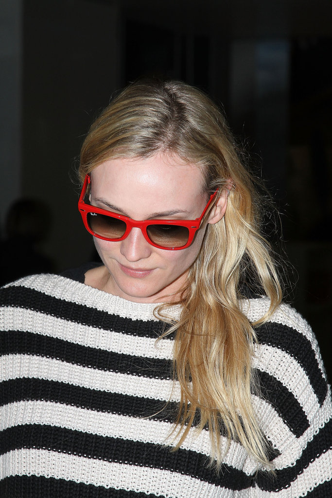 Diane Kruger donned a pair of red sunglasses.