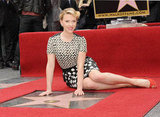 Scarlett Johansson posed with her brand-new star on the Hollywood Walk of Fame in May 2012.