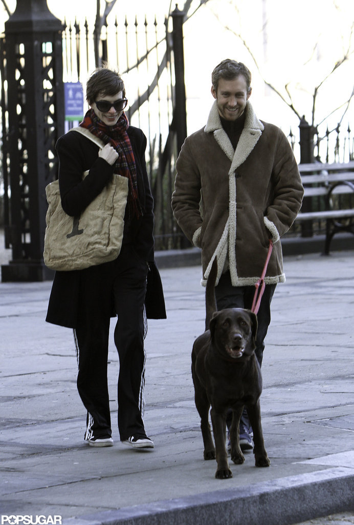 Anne Hathaway and Adam Shulman smiled during a stroll with their dog.