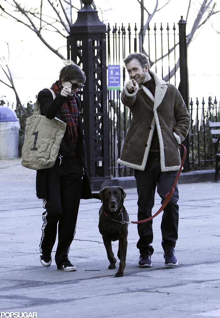 Anne Hathaway carried a tote bag while she walked alongside husband Adam Shulman and her dog.
