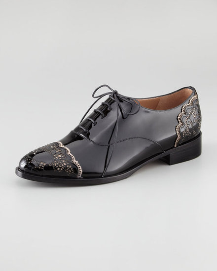 If you like to borrow from the boys, look no further than the Valentino patent leather derby ($795), which channels a cap toe brogue with the ultimate feminine touch: lace.