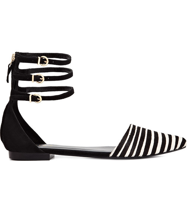 The black-and-white stripes of the Reiss Evette flat ($255), combined with its triple ankle strap, make this pair perfect for a bohemian girl.