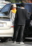 Gwen Stefani and Gavin Rossdale talked at their car.