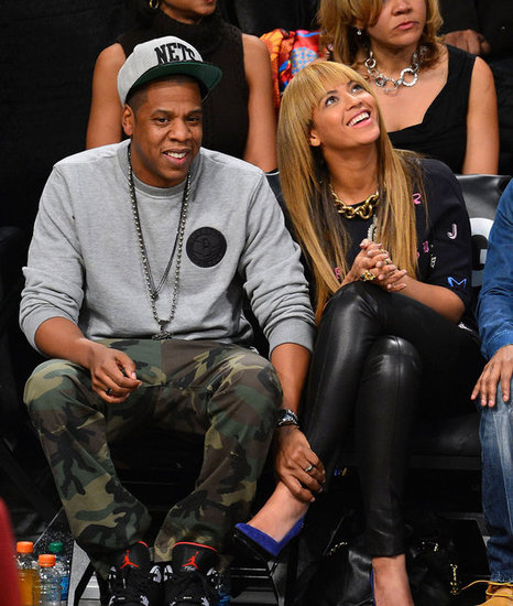 Beyonce Knowles and Jay-Z smiled at the Knicks game in NYC.