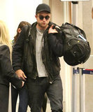 Robert Pattinson wore a hat and sunglasses.