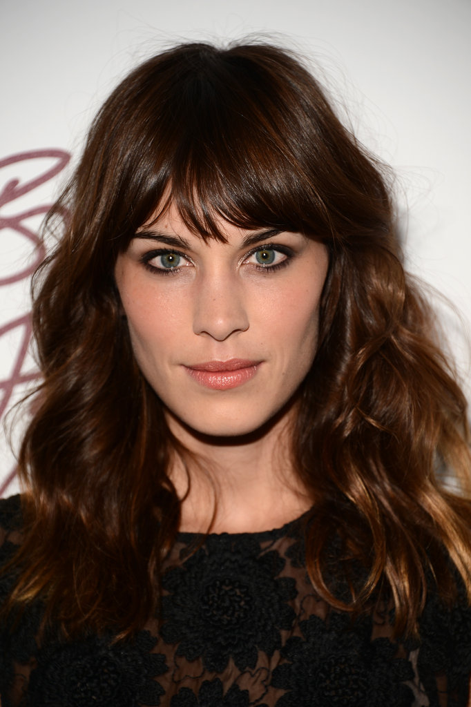 Alexa Chung gave a smile at the British Fashion Awards.