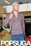 Liam Hemsworth arrived at the airport solo.