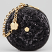 Forgo a regular sequined envelope clutch this holiday season, and carry this adorable Eric Javits sequined round wristlet ($185).