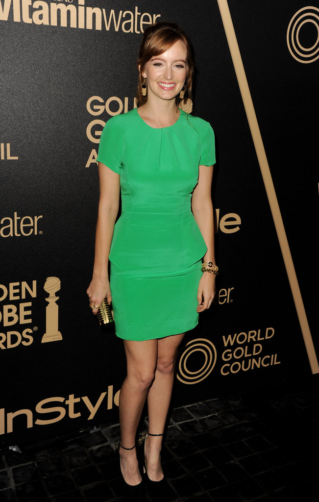 Ahna O'Reilly showed off a brilliant green hue on her perfectly fit little sheath dress, which she adorned with gold drop earrings, a coordinating gold clutch, and ankle-strap heels.