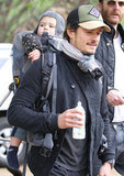 Orlando Bloom carried Flynn Bloom's bottle.