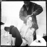 Alessandra Ambrosio chatted on the phone while her makeup artist tended to her hair. Source: Instagram user wattsupphoto