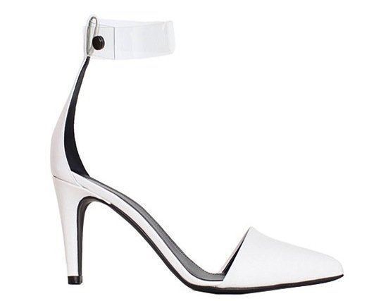 Tibi's Shane Clear Strap Pumps ($435) are classic and minimalistic, but with a space-age twist. I love the clear PVC ankle strap and clean pointed toe — they will look great with holiday party looks but also work well for a normal day at the office. — Britt Stephens, assistant editor
