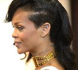 We love Rihanna's half ladylike, half cool-girl shaved hairdo — check out those tattoos!