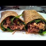 This whole-grain wrap of tuna, capers, sundried tomatoes, and fresh greens looks like a protein powerhouse.   Source: Instagram user zsanettkorosi