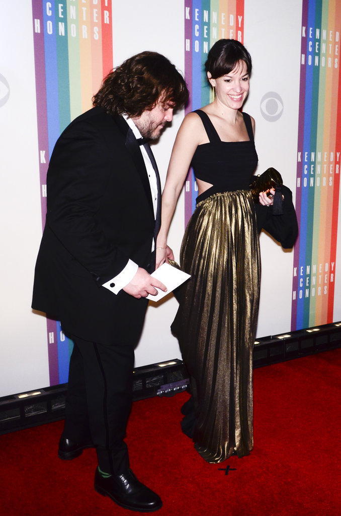Presenter Jack Black held hands with wife Tanya Haden.