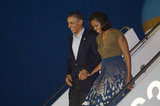 Barack and Michelle held hands during an arrival.