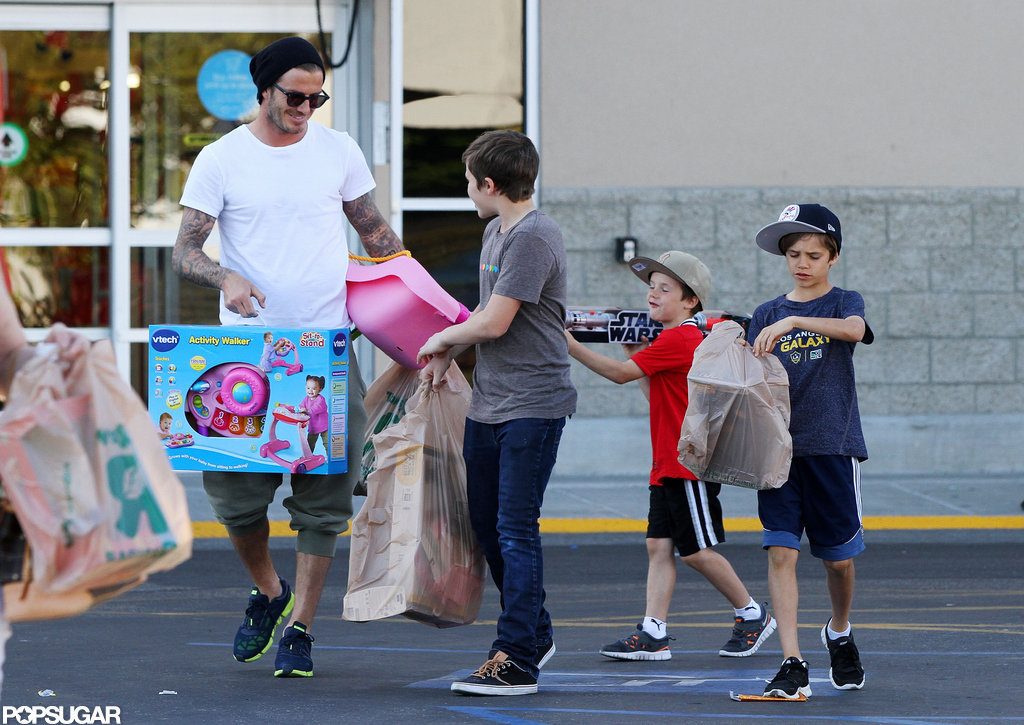 David Beckham and his boys went toy shopping for Harper in LA in March.