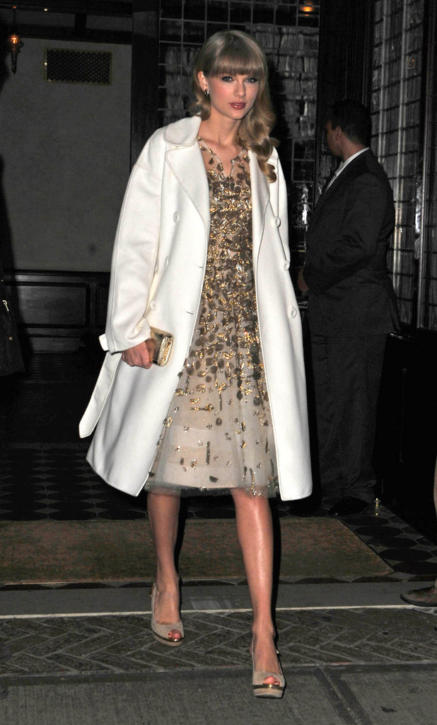 Taylor Swift stepped out in a white coat for the gala.