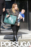 Hilary Duff walked out of a store in LA carrying Luca Comrie.