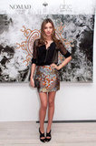 Miranda Kerr styled up a Proenza Schouler brocade mini with a semi-sheer black button-down and heels — the kind of look that's even office-party appropriate.