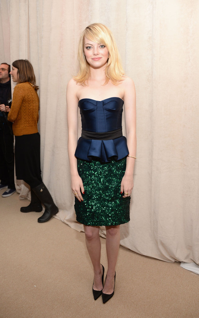 The rich jewel tones on Emma Stone's Burberry Prorsum dress are holiday-perfect.