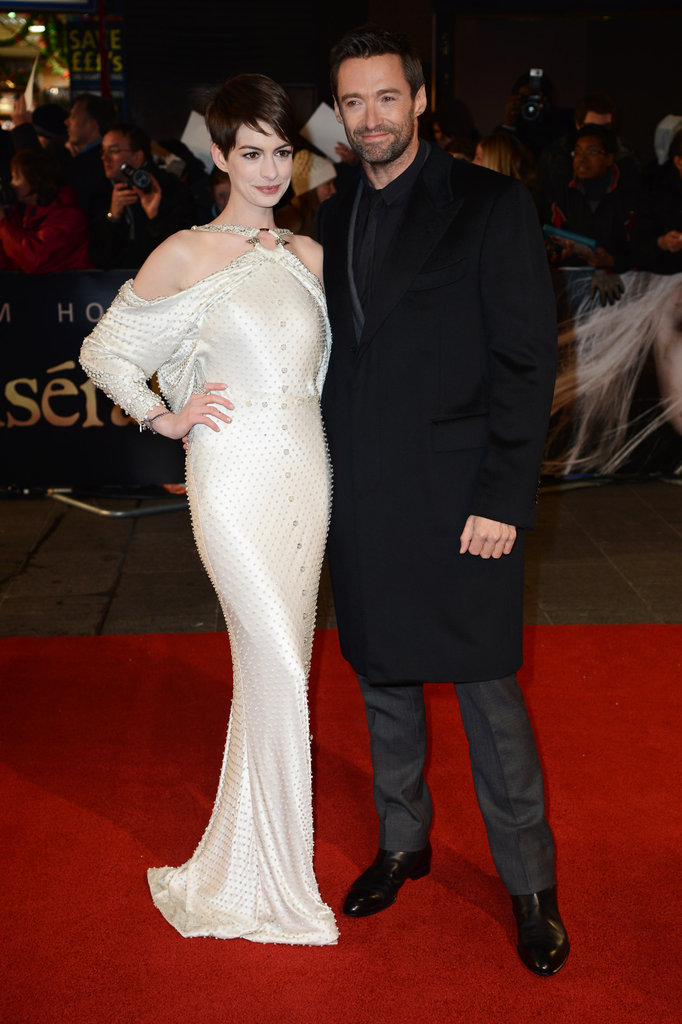One last shot of Anne and her Les Misérables costar Hugh Jackman on the red carpet. What do you think of her premiere look? Tell us in the comments below!