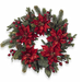 Bring holiday sprit to your entryway and welcome guests with a Poinsettia & Berry Wreath ($70).