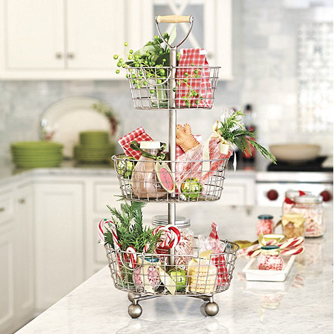 Put Christmas ornaments on display in a similar fashion with this Southern Living Tiered Wire Basket ($89).