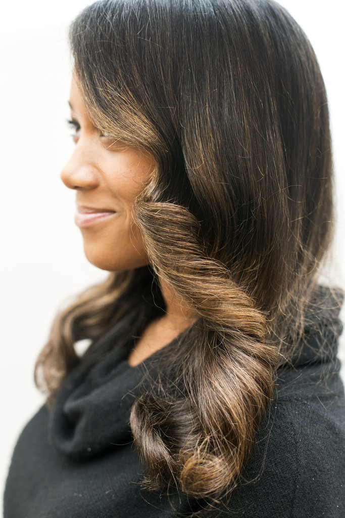 And to achieve the perfect vintage wave, use a paddle brush to clump curls together. But if you want a more formal updo, here's how you can take this glamorous look up a few more notches . . .