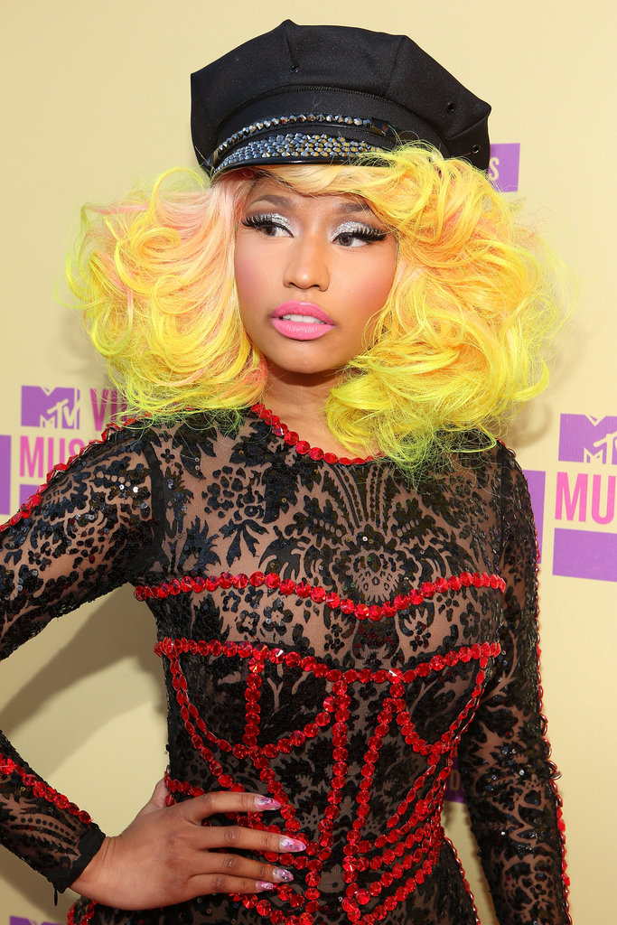 Nicki accessorized her bright hair and sparkly glitter shadow with some seriously cool nail art at the 2012 MTV VMAs.