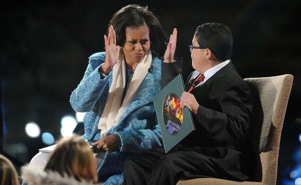 Michelle Obama and Modern Family's Rico Rodriguez high-fived as they read a book to kids.