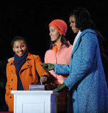 The Obama girls flipped the switch on the national Christmas tree.