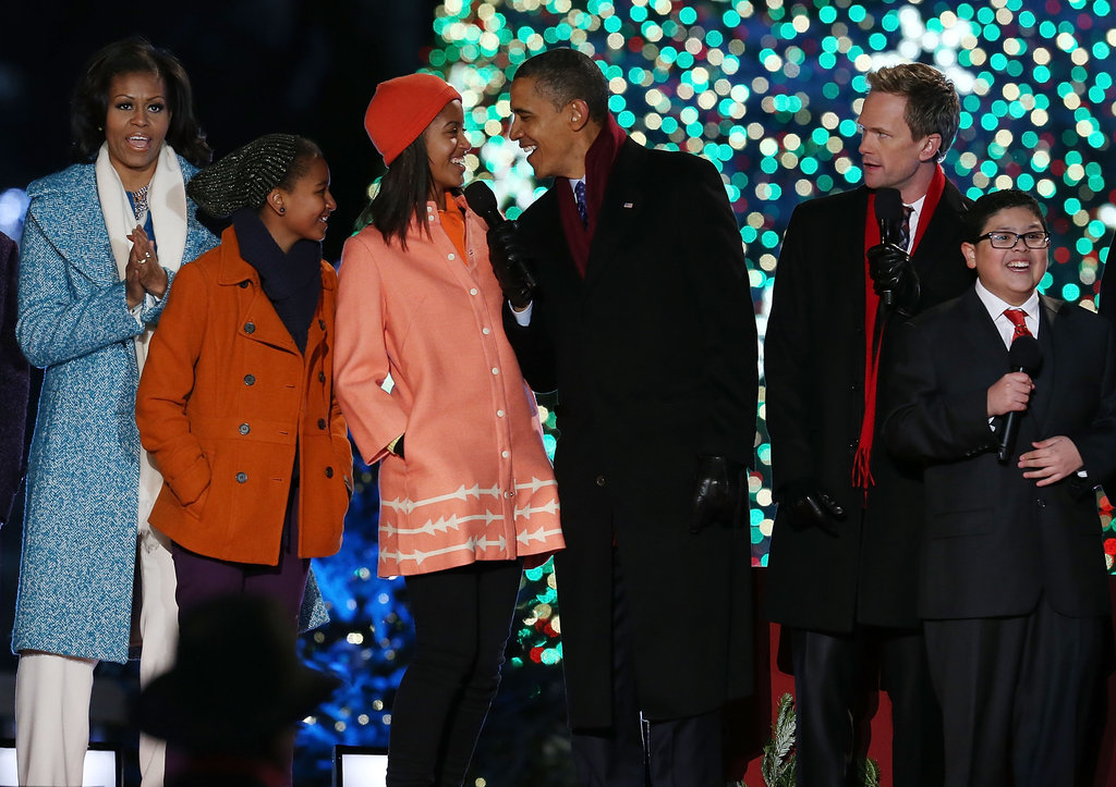The Obama girls both wore adorable orange coats.