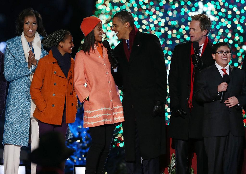 The Obama girls both wore adorable orange coats.