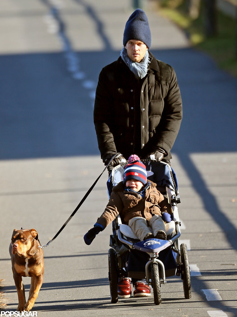 Tom Brady and Benjamin Brady walked in Boston with their dog.