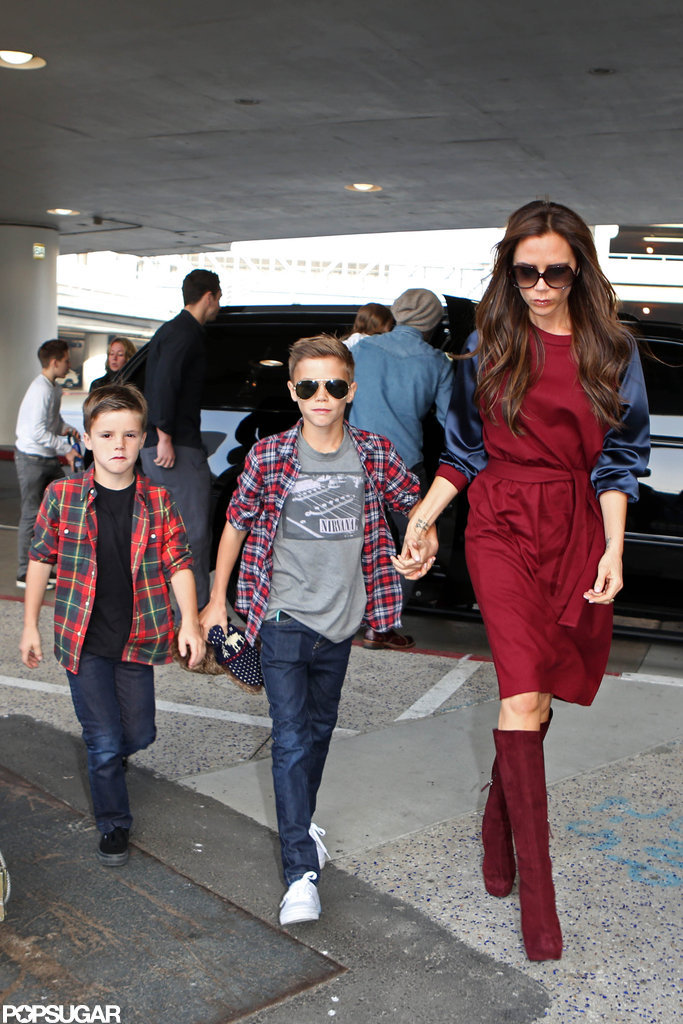 Victoria Beckham walked with Romeo and Cruz.