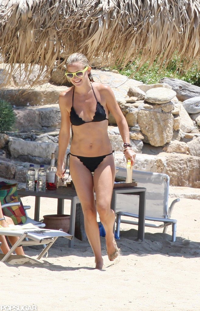 Kate Hudson rocked a black bikini and bright shades while vacationing in Greece this July.